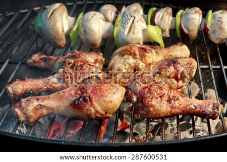 BBQ Roasted Chicken Legs And Mushrooms On The Hot Charcoal Grill - stock photo