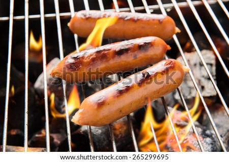 BBQ sausages on the grill - stock photo