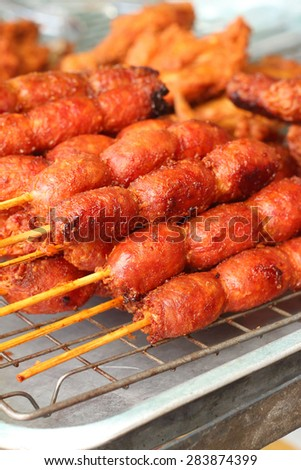 BBQ sausages on the grill in the market - stock photo