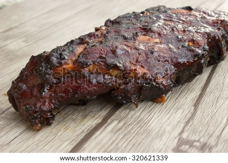 Bbq Spareribs on wooden background - stock photo