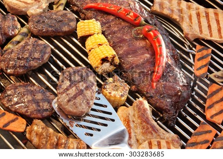 BBQ Spareribs, Steaks, Hamburger Patties, Corn And Pepper On The Hot Charcoal Grill. Cookout Food For Summer Weekend Picnic, Outdoor Dinning Or Party.