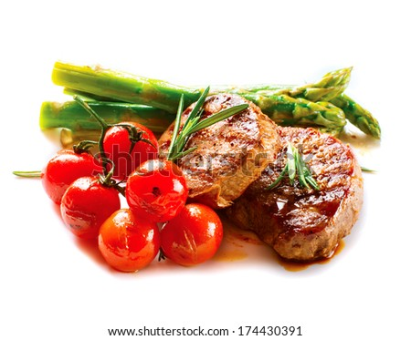 BBQ Steak. Barbecue Grilled Beef Steak Meat with Vegetables. Healthy Food. Barbeque Steak Dinner isolated on a white background - stock photo