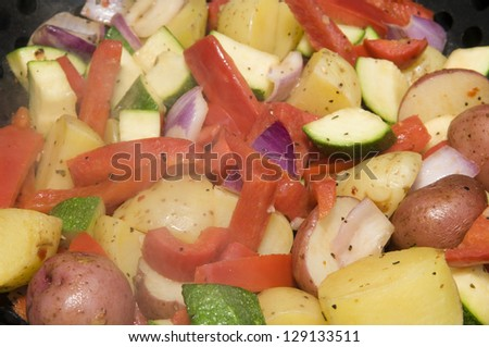 BBQ vegetable medley including, potato, peppers and onions - stock photo