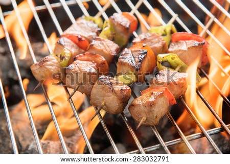 BBQ with cooking. coal grill of chicken meat and peppers.