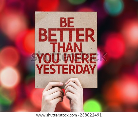 Be Better Than You Were Yesterday card with colorful background with defocused lights - stock photo