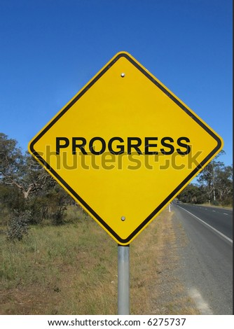 Be careful what you wish for. Yellow warning sign with a word - progress. - stock photo