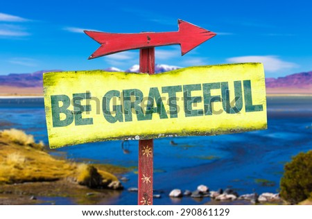 Be Grateful sign with landscape background