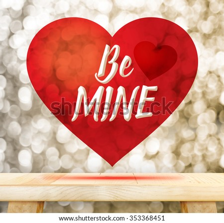 Be mine word in red heart floating above wood table at gold blur bokeh, Valentines concept - stock photo