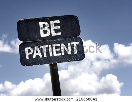 Be Patient sign with clouds and sky background