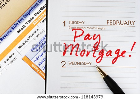 Be sure to pay the home mortgage on time - stock photo