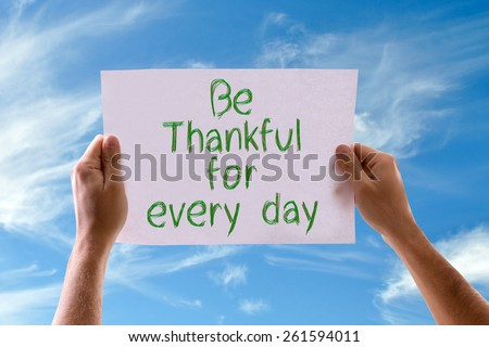 Be Thankful for Every Day card with sky background - stock photo