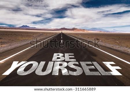 Be Yourself written on desert road - stock photo