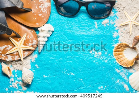 beach accesories on blue background - stock photo