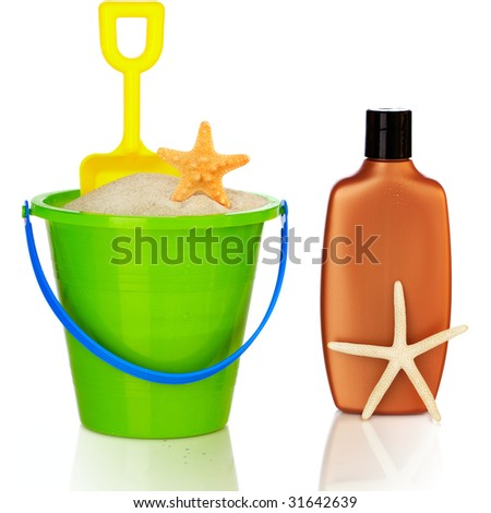 Beach Accessories ~ Colorful Green & Blue Pail Filled With White Sand And Yellow Shovel , Starfish Shells And Sunscreen - stock photo