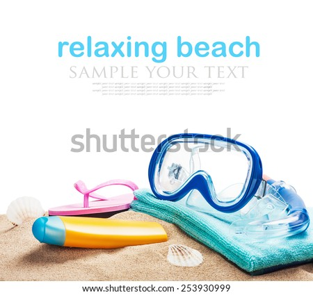 beach accessories for relaxing on the sand on a white background. The text is an example and can be easily removed - stock photo