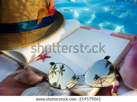 beach accessories on beach chair  - stock photo
