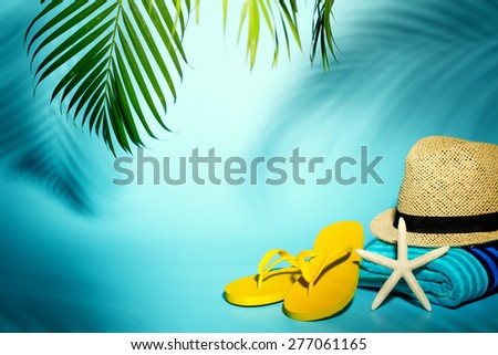 Beach accessories on blue background - stock photo