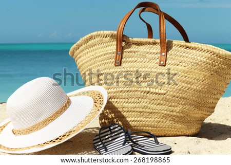 beach accessories on the sand sunny day - stock photo