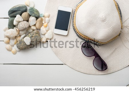 beach accessories on wooden board and background