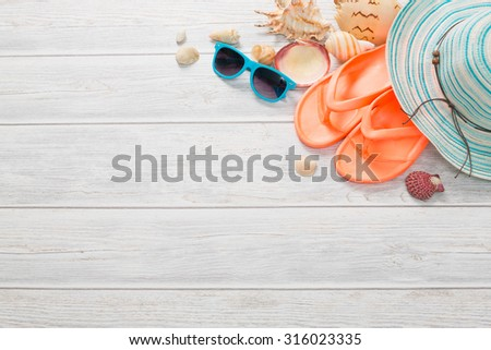 Beach accessories on wooden board. Concept of the summer time. - stock photo