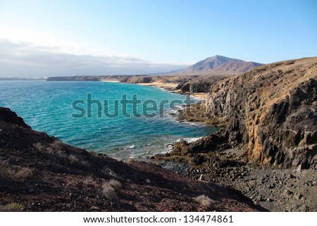 Beach and bay, Lanzarote, Spain - View of a beautiful bay and beach at the Playas de Papagayo, Lanzarote, Canary Islands, Spain. - stock photo
