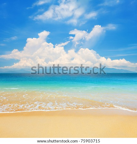 beach and beautiful tropical sea with island - stock photo