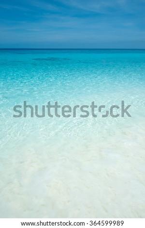 Beach and blue sea, sky horizon. - stock photo