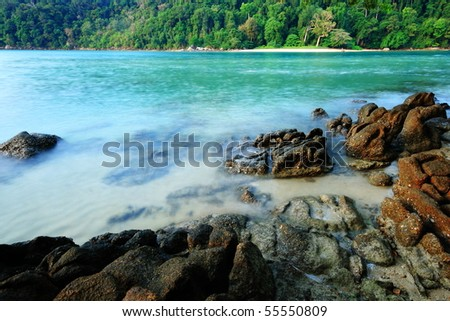 beach and blue water - stock photo