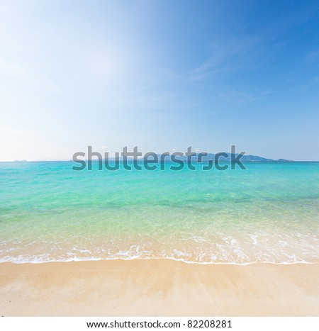 beach and clear tropical sea - stock photo