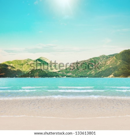 Beach and mountains island, clear sand - stock photo