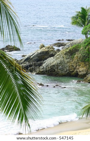 Beach and rocks on the ocean - stock photo