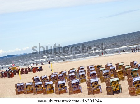 Beach and roofed wicker beach chairs Baltic sea - stock photo