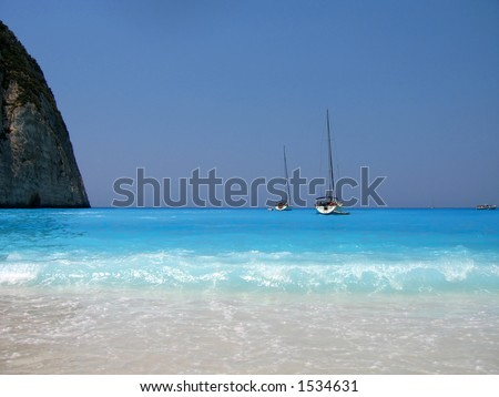 beach and sail boats in Greece - stock photo