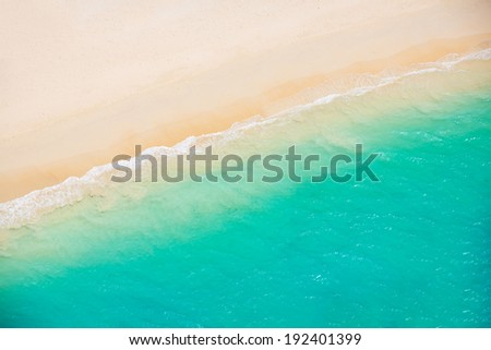 Beach and Sea. Aerial view from helicopter of tropical ocean meeting the sand - stock photo