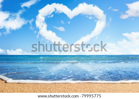 beach and sea. Heart of clouds on sky. Symbol of love - stock photo