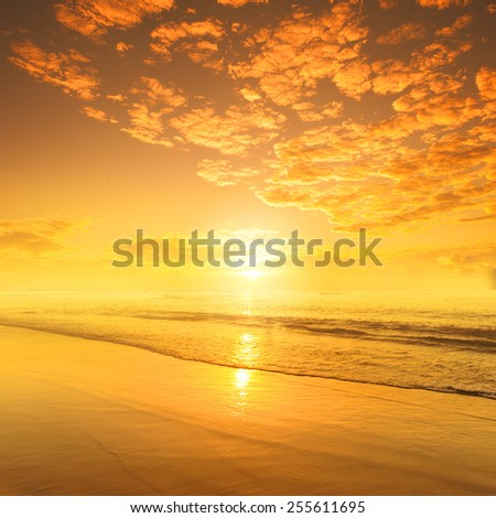 Beach and sea in sunset - stock photo