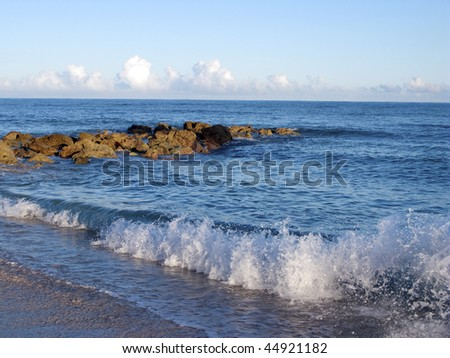 beach and sea with waves - stock photo