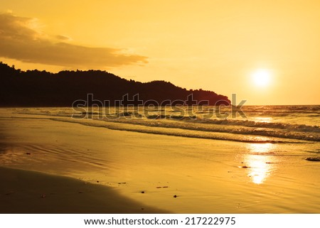 Beach and sunset - stock photo