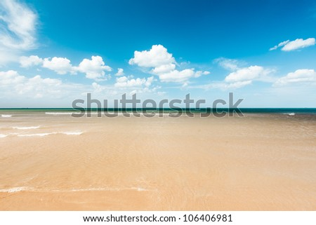 Beach and the clouds - stock photo