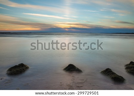 Beach and the stones in the Baltic Sea at sunset - stock photo
