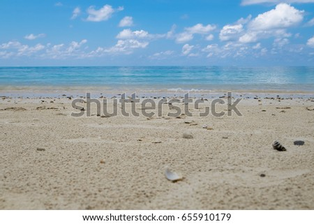 Beach and tropical sea in a nice day, Focus at the middle of image