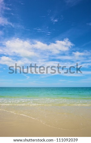 beach and tropical sea under the bright blue sky at summer day - stock photo