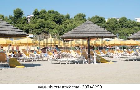 Beach and umbrella - stock photo