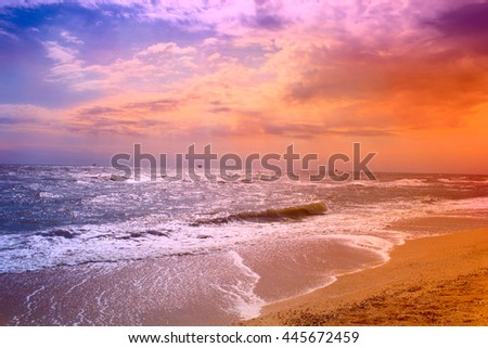 beach and waves of the sea, storm clouds - stock photo