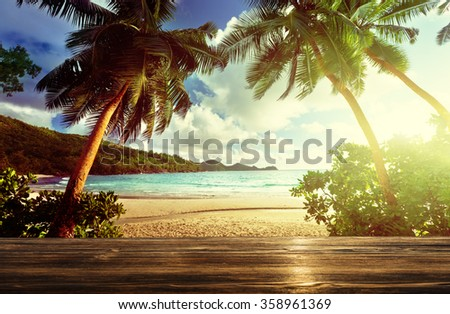 beach and wooden pier - stock photo