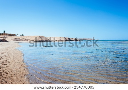 Beach at a luxury typical unrecognizable 5 star hotel in Egypt, Africa. Holiday resort in Egypt. sharm el sheikh. hurgada. - stock photo