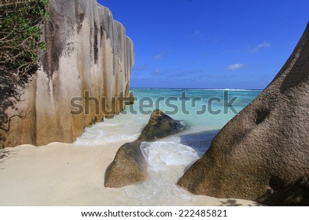 Beach at La Digue, Seychelles island, with palm tree and turquoise water . - stock photo