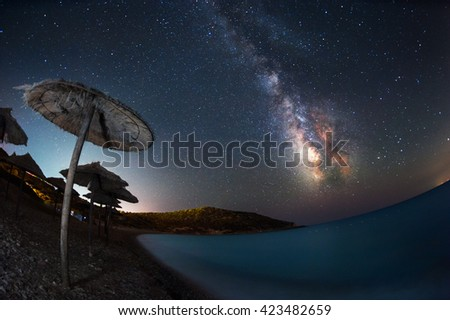 Beach at night under the milky way - stock photo