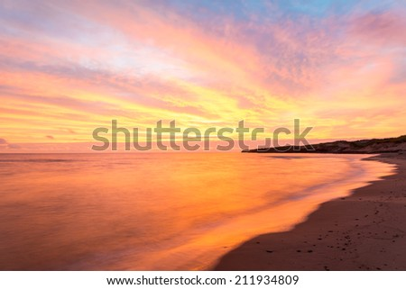 Beach at the crack of dawn (Green Gables Shore, Prince Edward Island, Canada) - stock photo