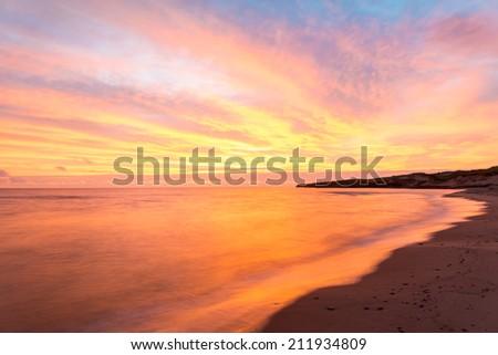 Beach at the crack of dawn (Green Gables Shore, Prince Edward Island, Canada) - stock photo